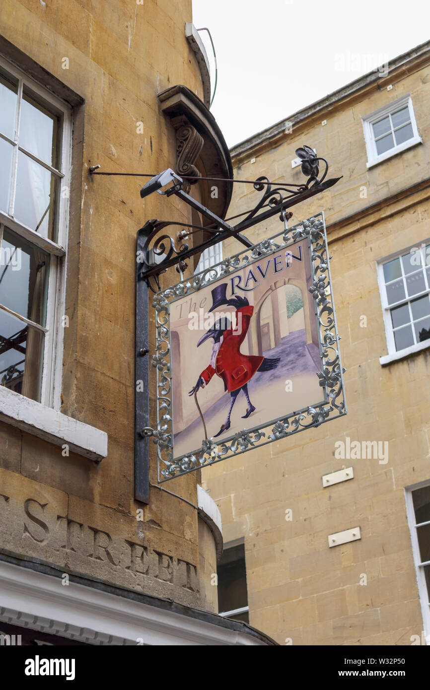 View looking up at the pub sign for The Raven of Bath, a traditional pub in Quiet Street in Bath, the largest city in Somerset, south-west England, UK - Stock Image