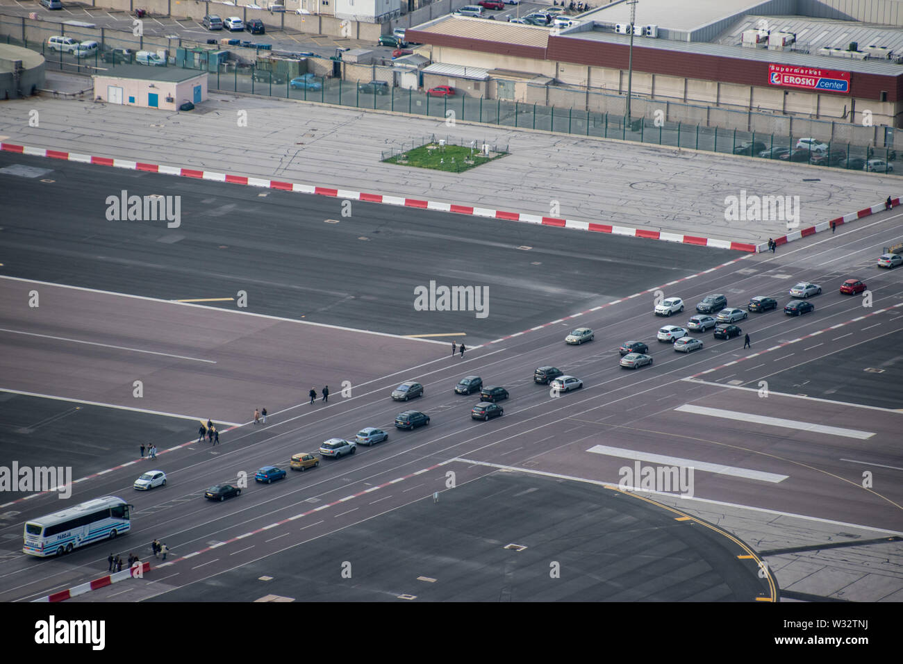 One of the few locations in the world with a public road crossing an active runway in Gibraltar - Stock Image