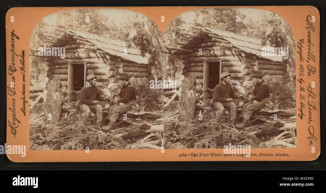 The first white man's log cabin, Haines, Alaska, by Singley, B L (Benjamin Lloyd) - Stock Image
