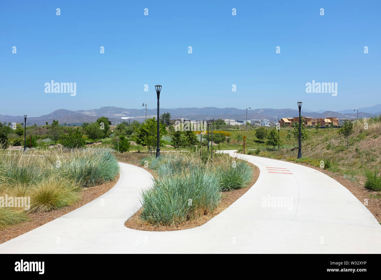 IRIVNE, CALIFORNIA - JULY 11, 2019: Fork in the road in the Great Park Bosque Area, a 53 acre open space area with bike and pedestrian trails. - Stock Image