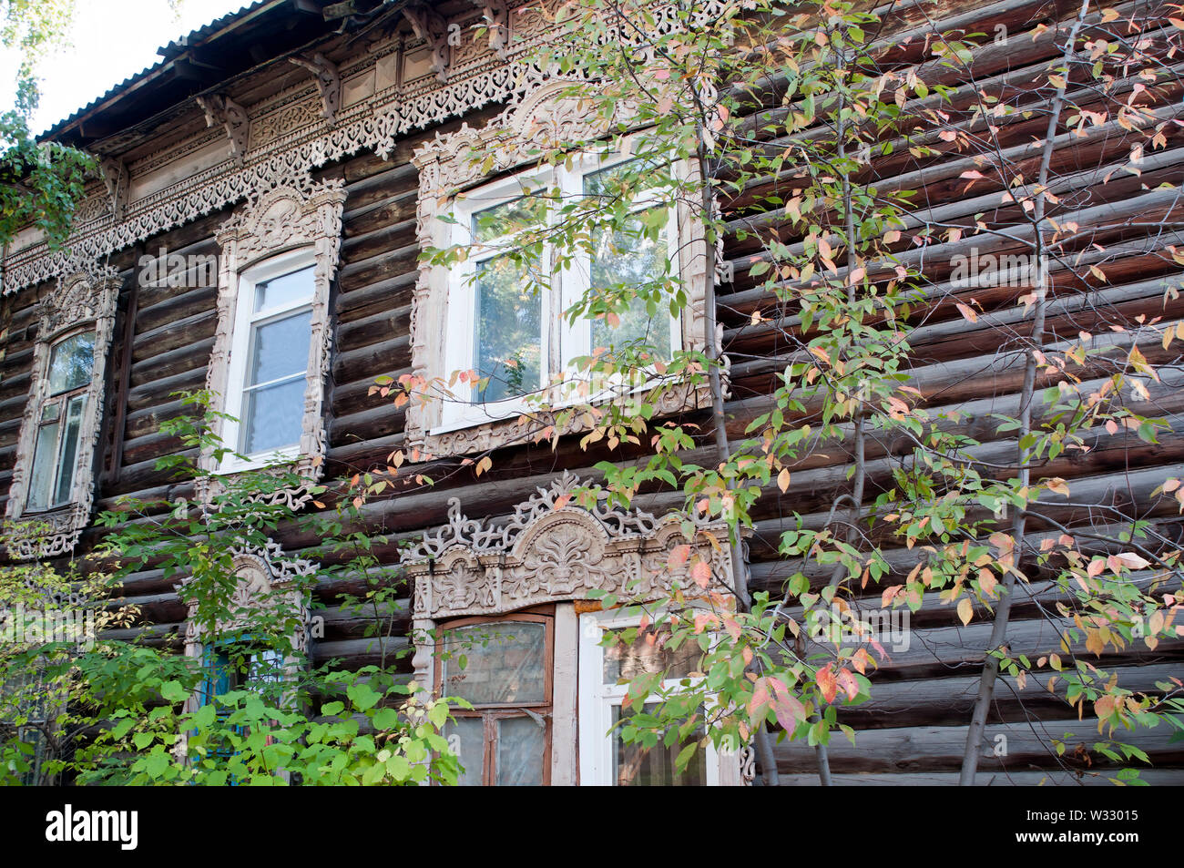 Tomsk Russia, Traditional lace windows decorating a log ...