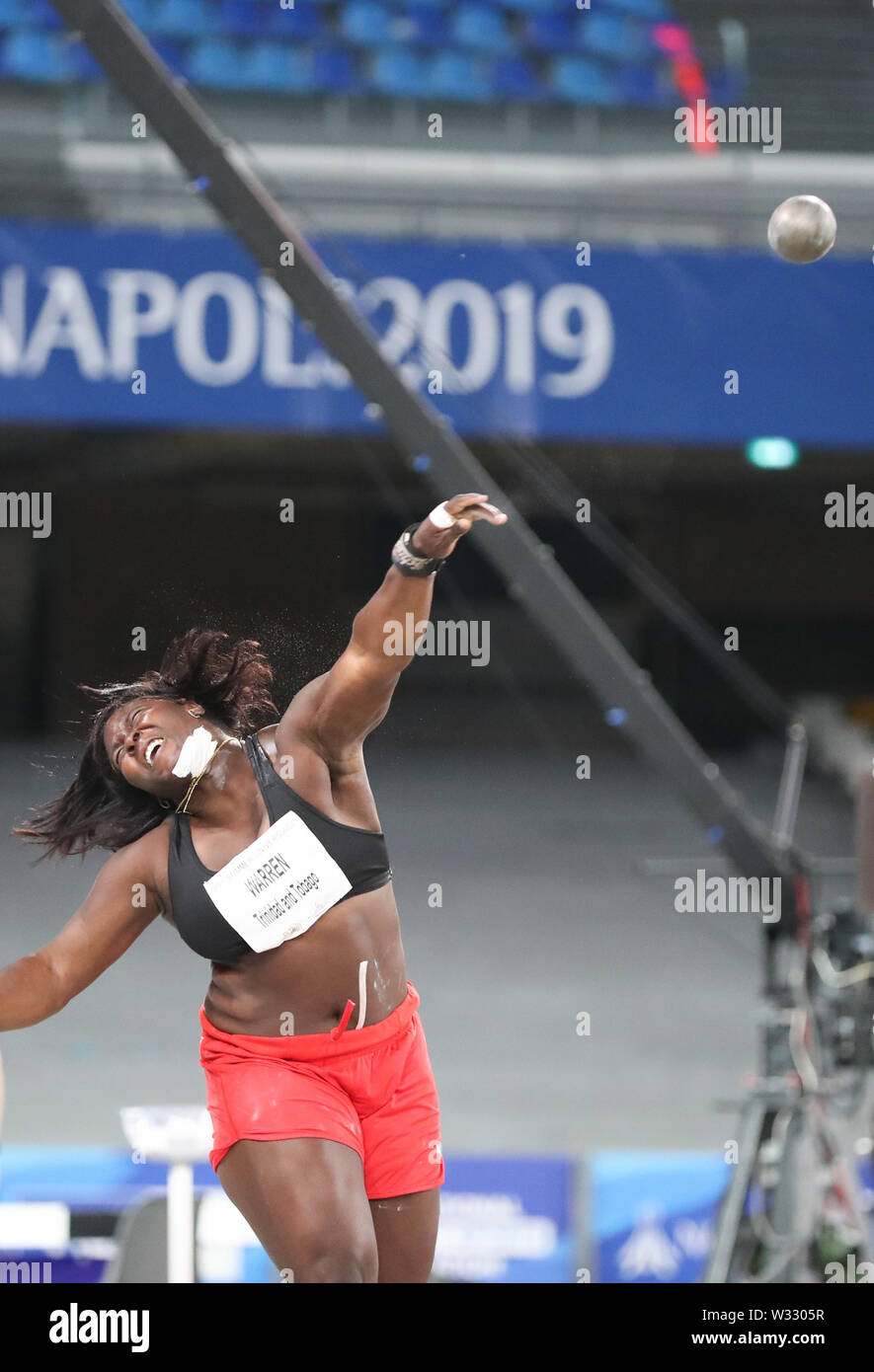 Naples, Italy. 11th July, 2019. Portious Warren of Trinidad and Tobago competes during the final of Women's Shot Put of Athletics at the 30th Summer Universiade in Naples, Italy, July 11, 2019. Warren won the silver medal with 17.82 meters. Credit: Cheng Tingting/Xinhua/Alamy Live News - Stock Image