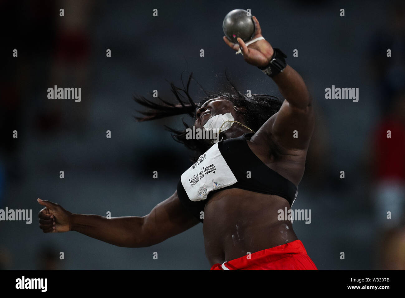 Naples, Italy. 11th July, 2019. Portious Warren of Trinidad and Tobago competes during the final of Women's Shot Put of Athletics at the 30th Summer Universiade in Naples, Italy, July 11, 2019. Warren won the silver medal with 17.82 meters. Credit: Zheng Huansong/Xinhua/Alamy Live News - Stock Image
