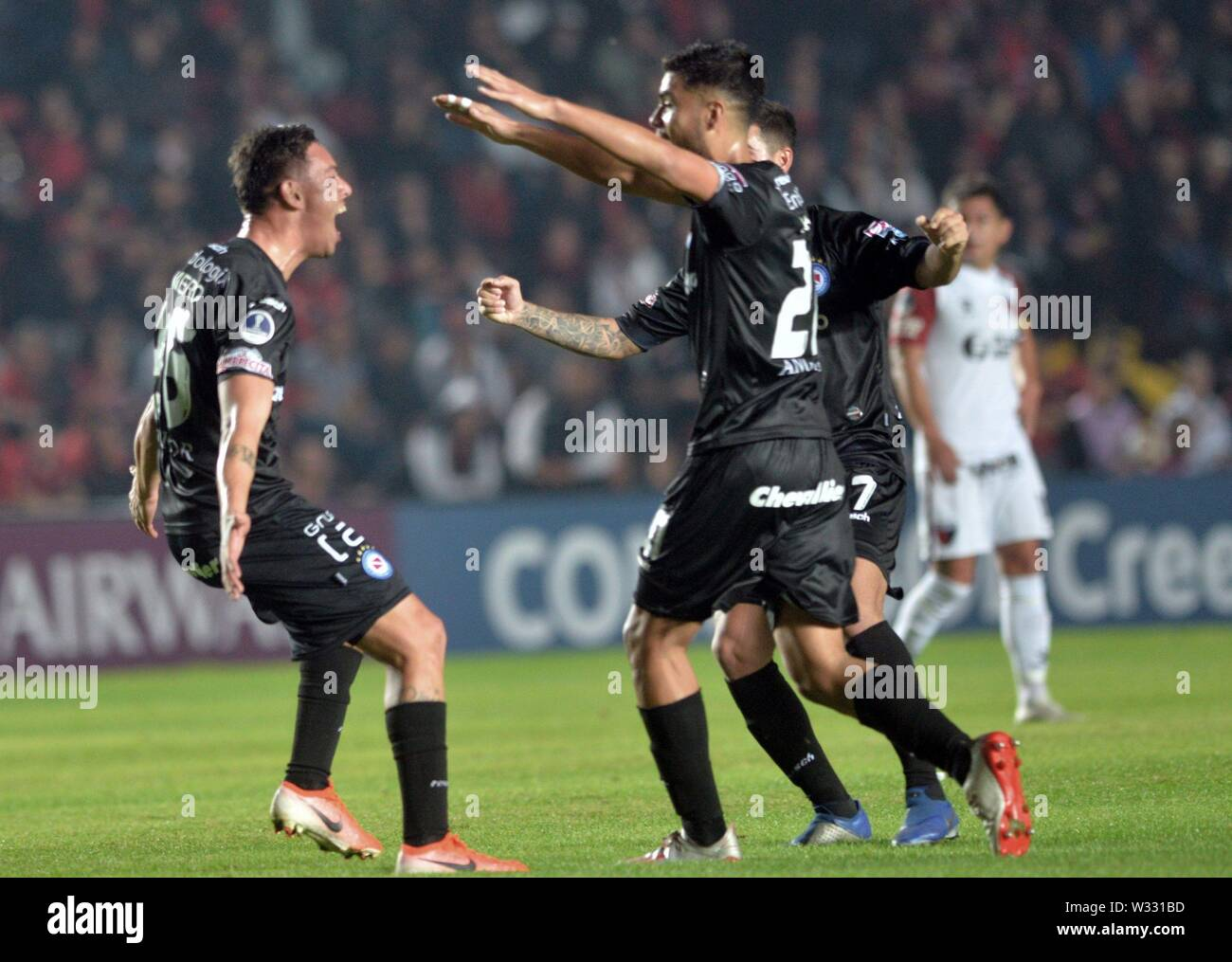 Santa Fe, Argentina. 12th July, 2019. Players of Argentinos Juniors celebrate the 1-0 lead during the Copa Sudamericana round of 16 first leg match between Club Atletico Colon and Asociacion Atletica Argentinos Juniors at the Brigadier General Estanislao Lopez stadium in Santa Fe, Argentina, 11 July 2019. Credit: JAVIER ESCOBAR/EFE/Alamy Live News - Stock Image