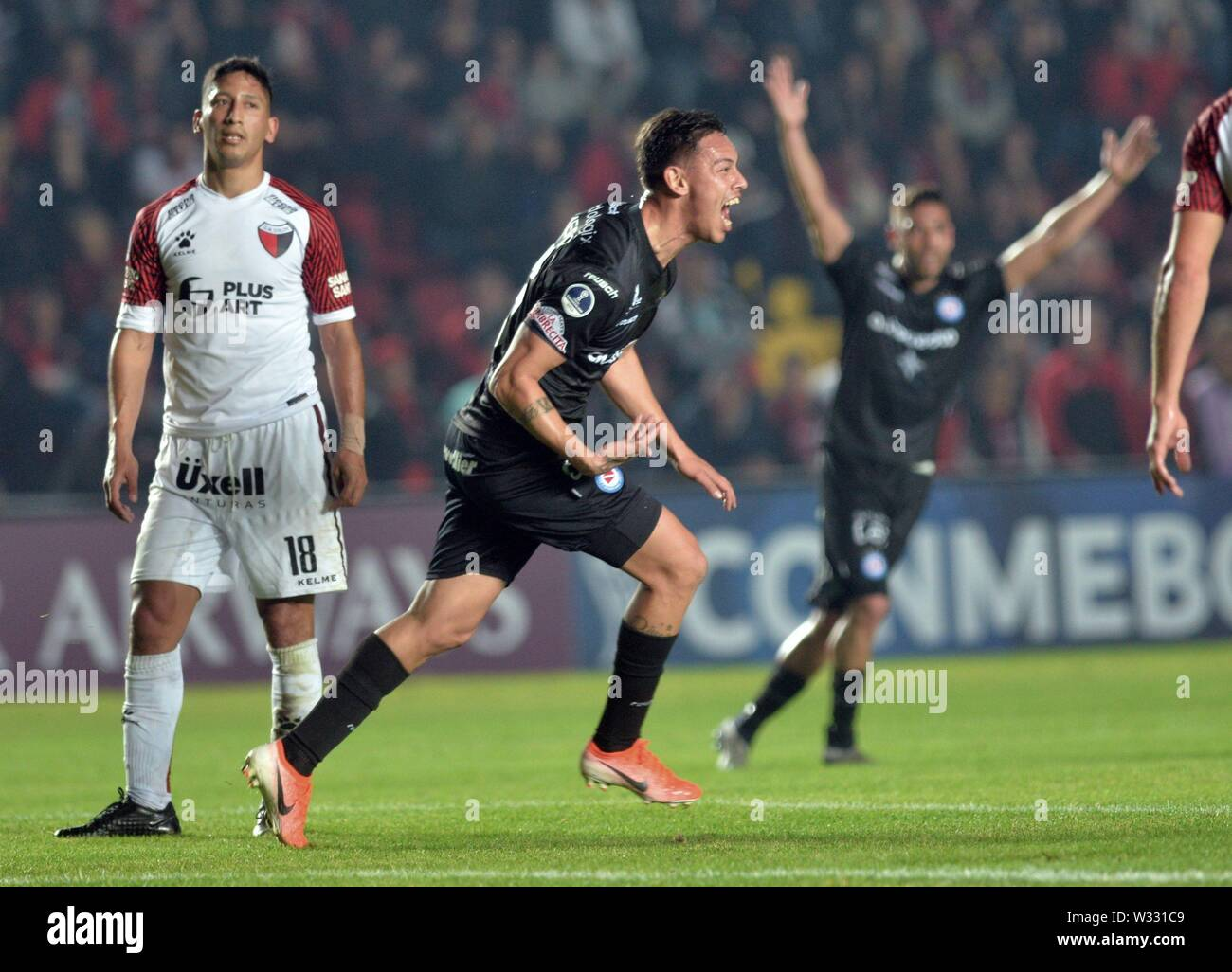 Santa Fe, Argentina. 12th July, 2019. Matias Romero (C) of Argentinos Juniors celebrates after scoring the 1-0 lead during the Copa Sudamericana round of 16 first leg match between Club Atletico Colon and Asociacion Atletica Argentinos Juniors at the Brigadier General Estanislao Lopez stadium in Santa Fe, Argentina, 11 July 2019. Credit: JAVIER ESCOBAR/EFE/Alamy Live News - Stock Image