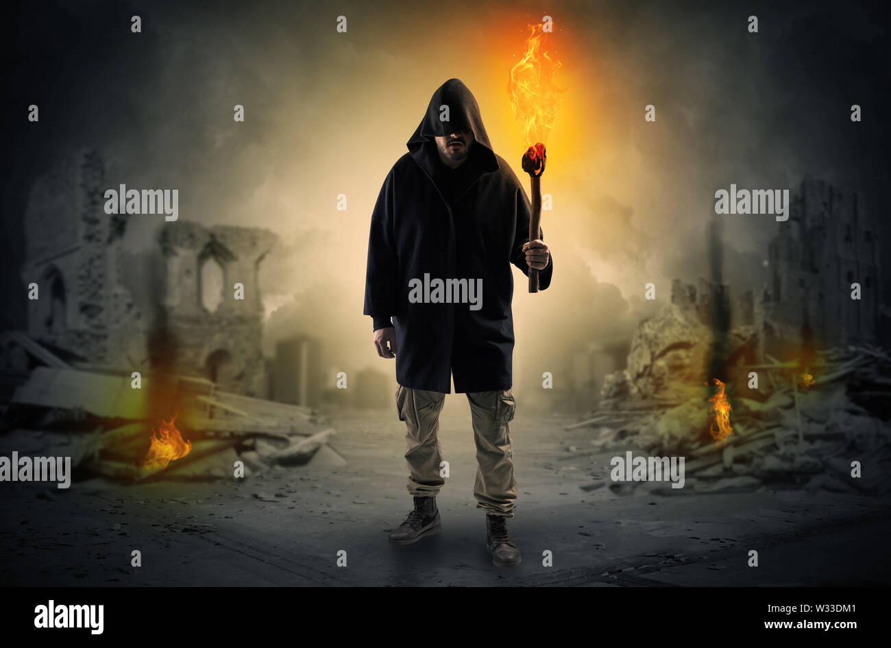 Destroyed place after a catastrophe with man and burning flambeau concept - Stock Image