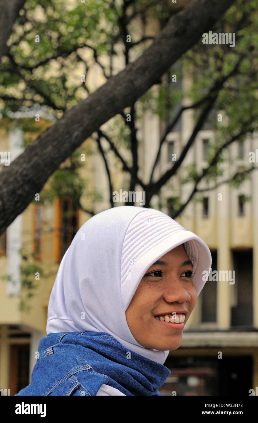 jakarta, dki jakarta / indonesia - december 08, 2008: a young woman wearing hijab on taman fatahillah in kota old town - Stock Image