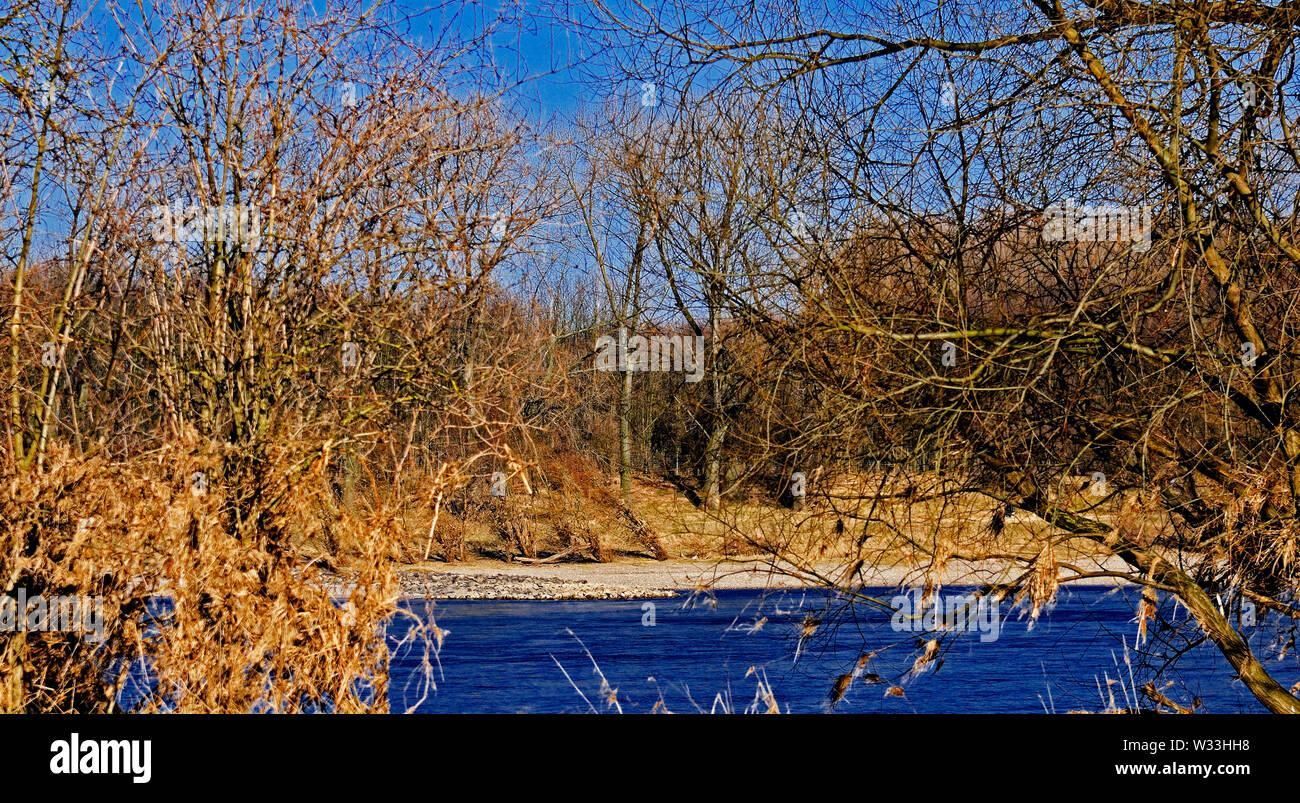 dormagen, germany - march 07, 2011: the river rhine flowing through the flatlands near dusseldorf - Stock Image