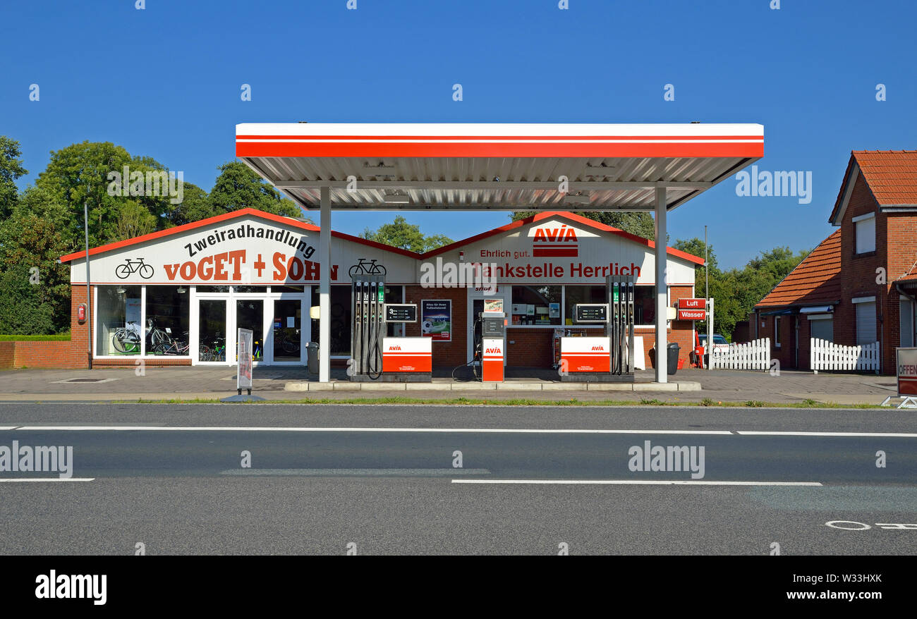westoverledingen, niedersachsen/germany - september 05, 2013: an avia gas station and a bicycle shop at federal road number 70 in between papenburg an - Stock Image