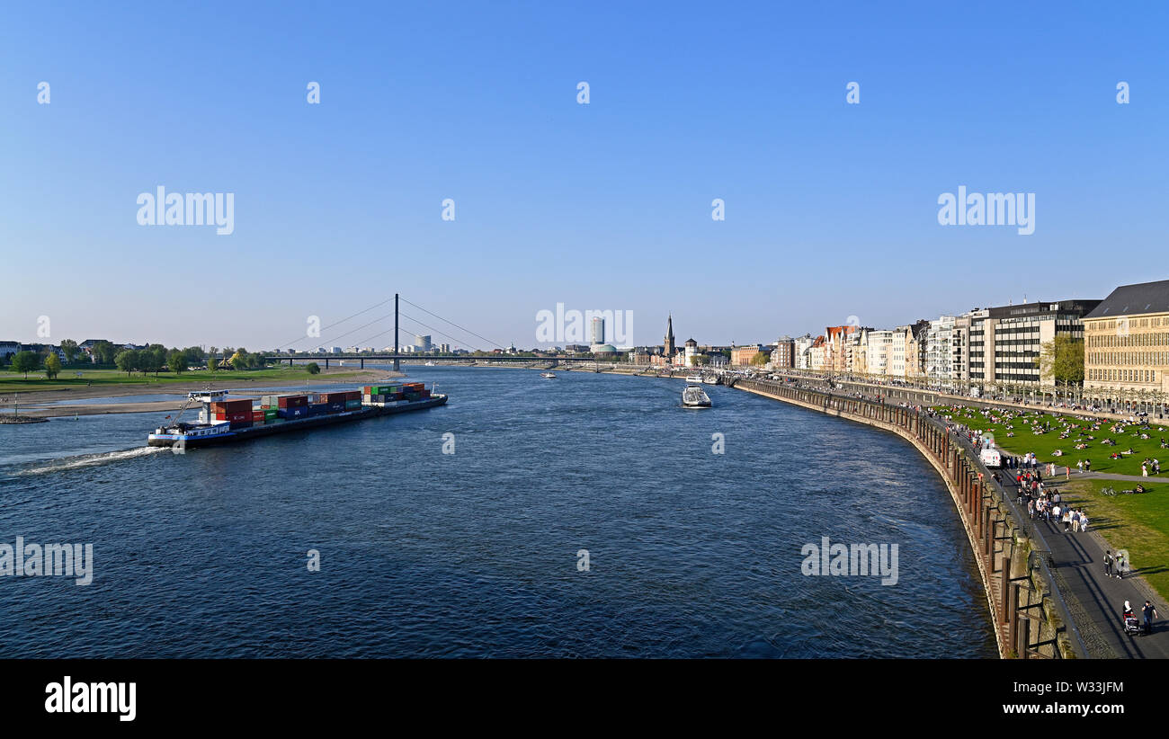 dusseldorf, germany - april 20, 2019:  people enjoying a sunny spring weekend at the bank of river rhine - Stock Image