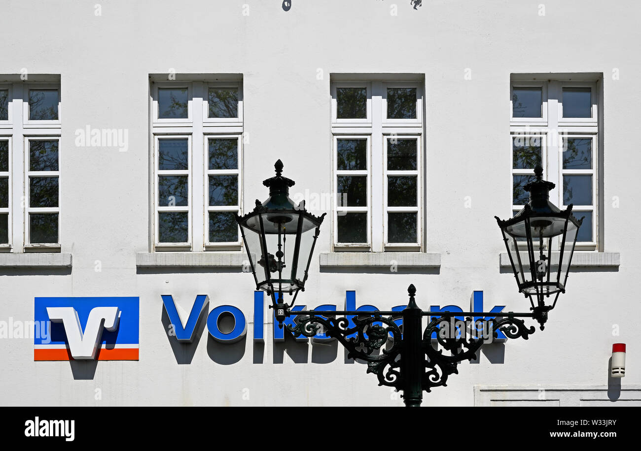 dusseldorf kaiserswerth, germany - april 20, 2019:   facade and logo of a volksbank branch in a building of 1766 in historical kaiserswerth suburb of - Stock Image