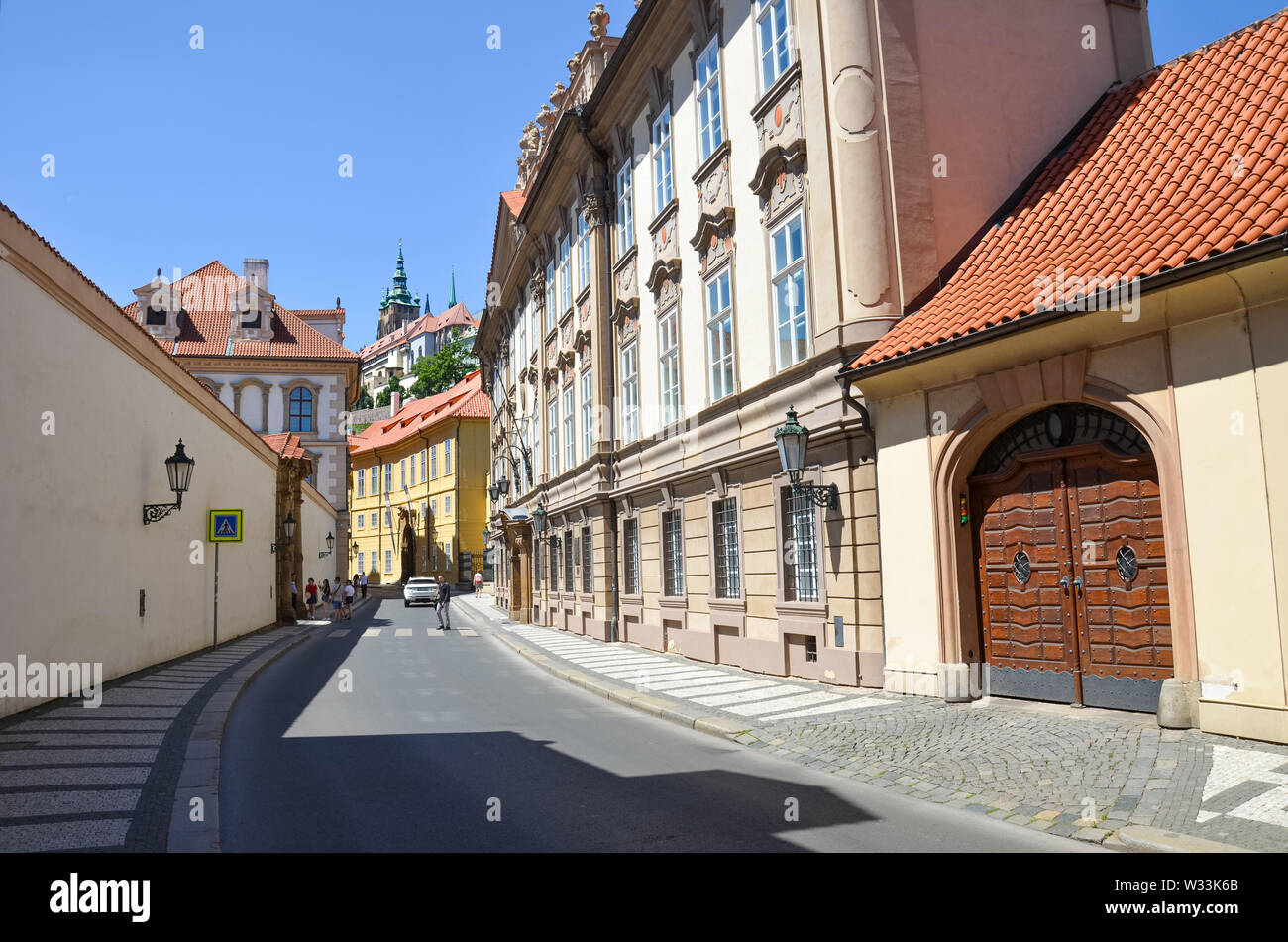 Prague, Czech Republic - June 27th 2019: Historical old town streets in Mala Strana, Lesser Town of Prague. Beautiful center of Czech capital. Prague Castle in background. Cityscape, Praha, Czechia. Stock Photo
