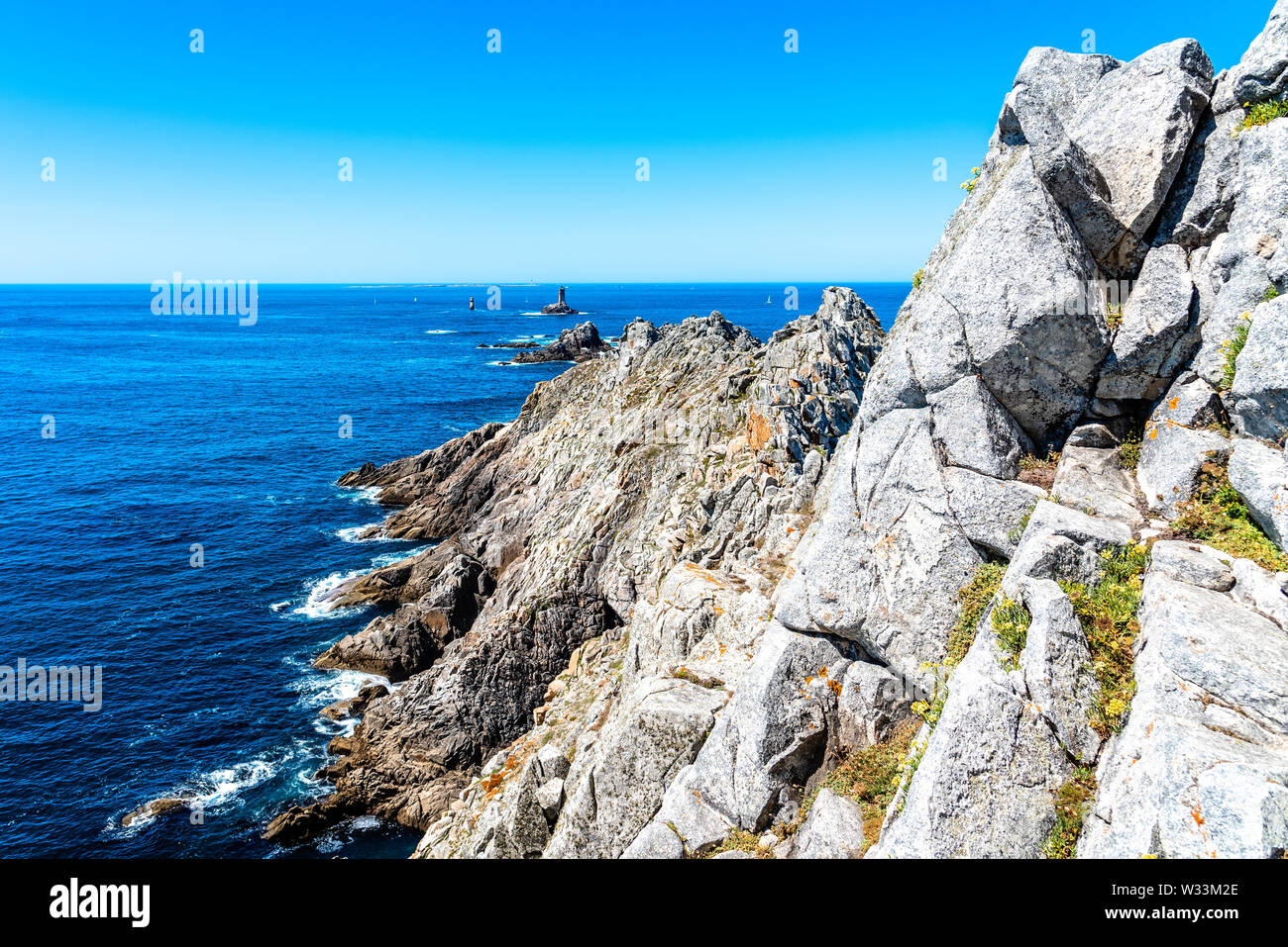 Scenic view of The Pointe du Raz. It is a promontory that extends into the Atlantic from western Brittany, in France. Stock Photo