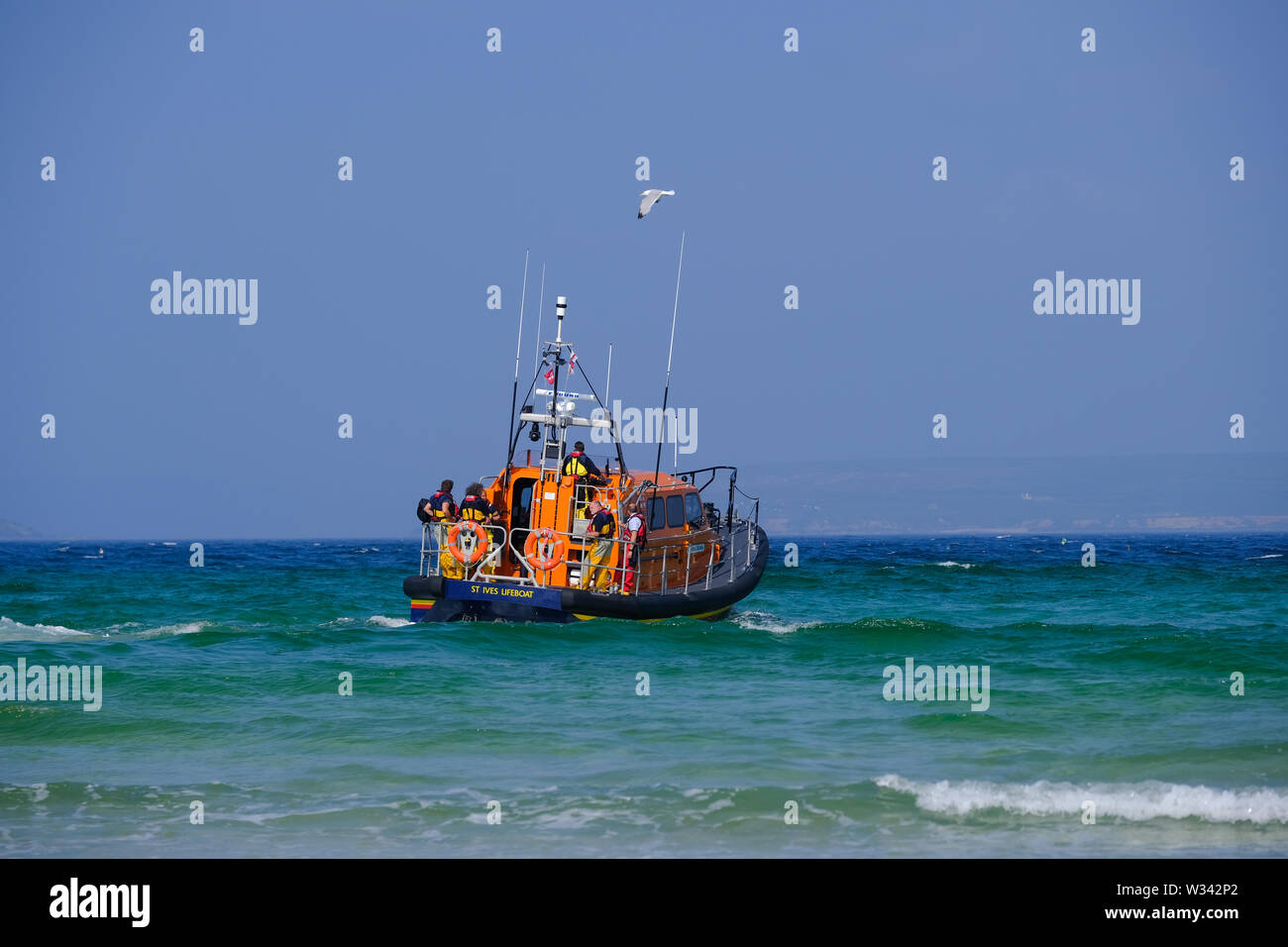The RNLI Lifeboat launching on an exercise at St Ives in Cornwall - Stock Image