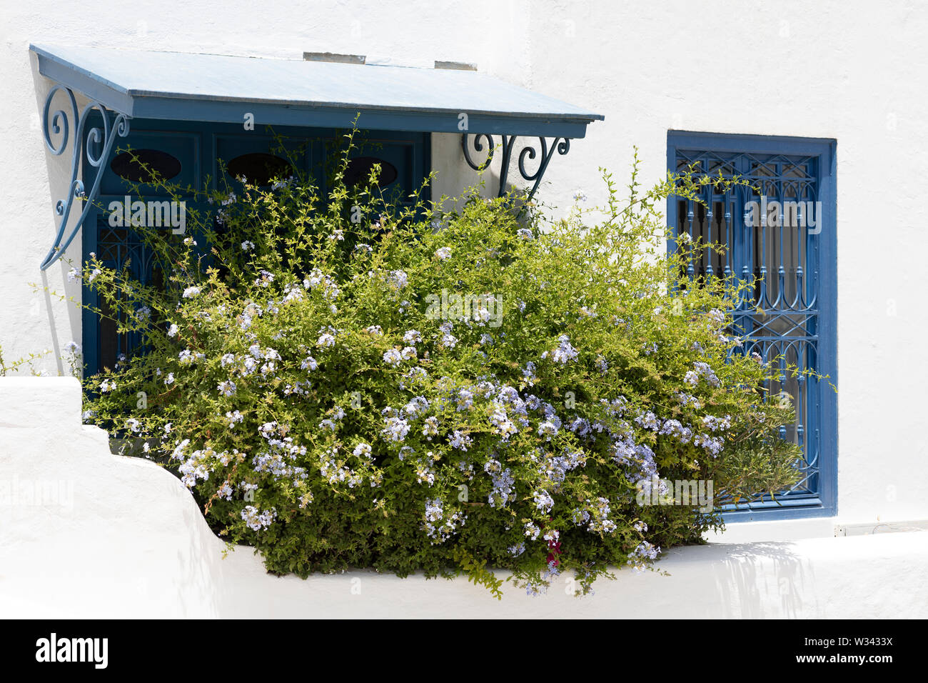 Sidi Bou Said, Tunisia - June.06, 2019: Alley with traditional white houses and blue doors. Stock Photo