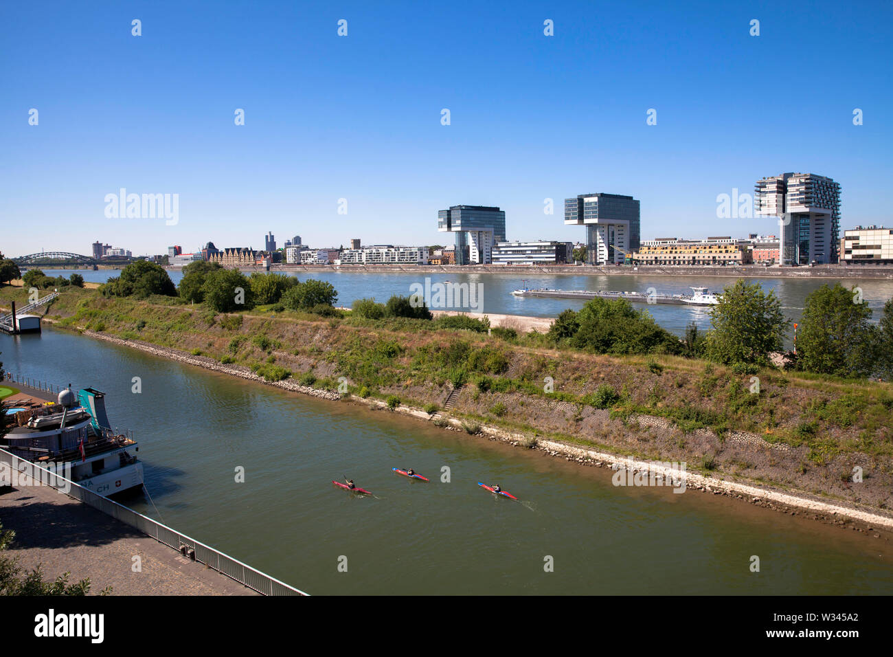 the Rhine harbor in the district Deutz, in the background the river Rhine and the Crane Houses at the Rheinau harbor, Cologne, Germany.  der Deutzer H - Stock Image
