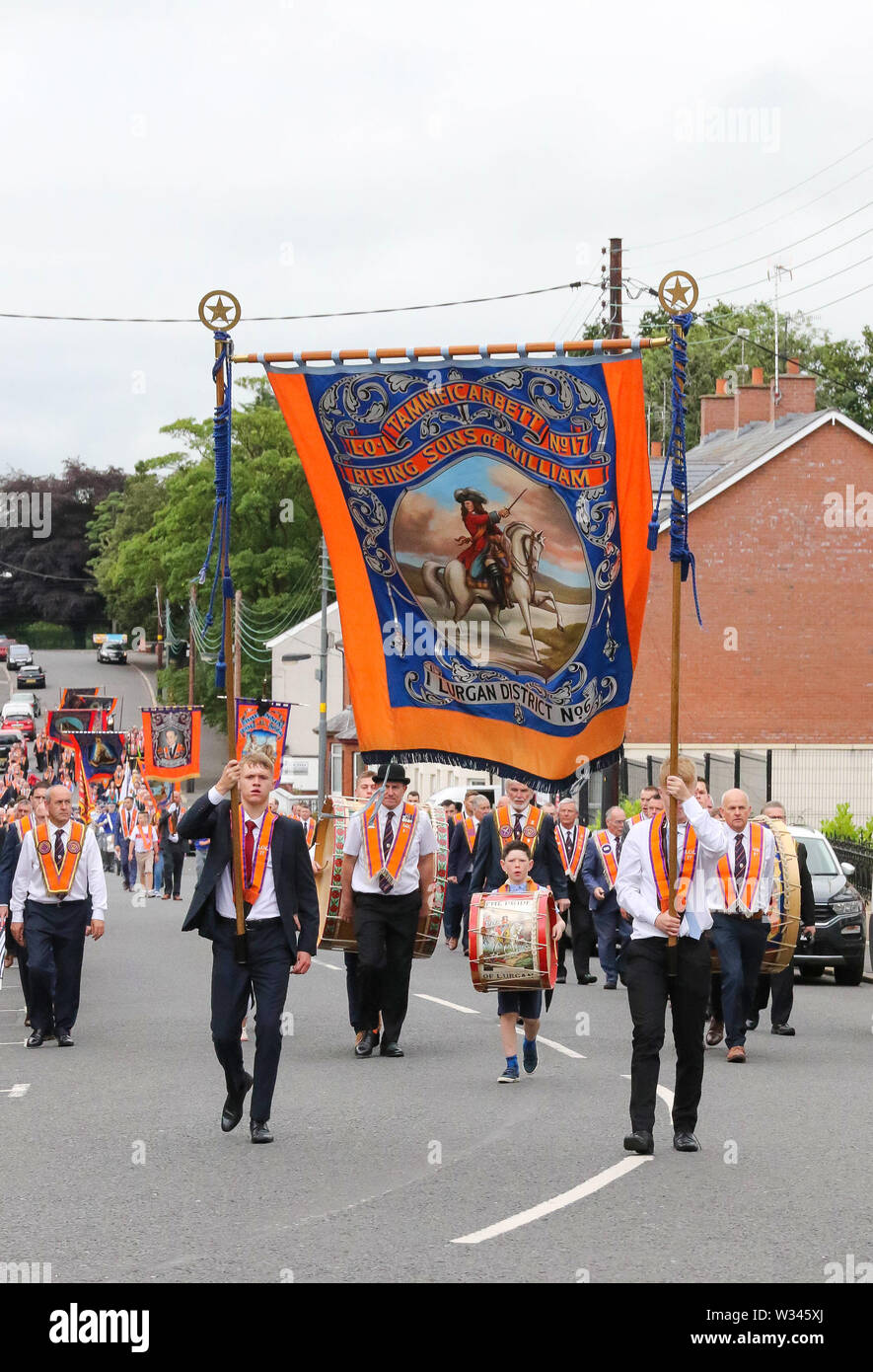 Lurgan, County Armagh, Northern Ireland.12 July 2019. The Twelfth of July is marked by Orange Order parades across Northern Ireland. Lurgan District left their headquarters at Brownlow House before parading up the town to the war memorial and then headed to the town of Tandragee for the main County Armagh demonstration. The parades across Northern Ireland mark the victory of William of Orange over James at the Battle of the Boyne in 1690. Credit: CAZIMB/Alamy Live News. - Stock Image