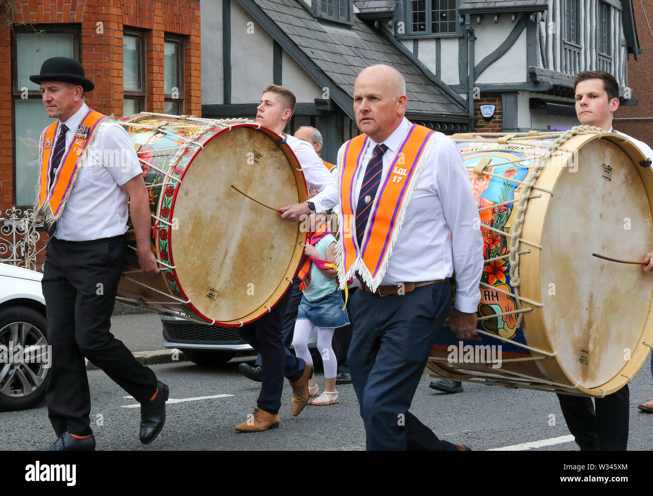Lurgan, County Armagh, Northern Ireland.12 July 2019. The Twelfth of July is marked by Orange Order parades across Northern Ireland. Lurgan District left their headquarters at Brownlow House before parading up the town to the war memorial and then headed to the town of Tandragee for the main County Armagh demonstration. The parades across Northern Ireland mark the victory of William of Orange over James at the Battle of the Boyne in 1690. Lambeg drums being played. .Credit: CAZIMB/Alamy Live News. - Stock Image
