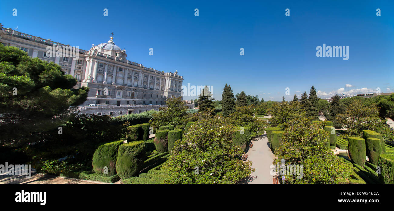 Madrid, Spain - June 21, 2019: Panoramic view of the Royal Palace of Madrid and the gardens of Sabatini Stock Photo