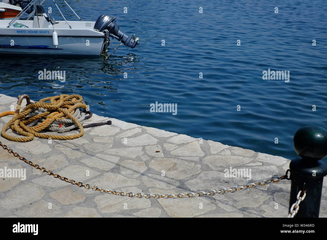 Corfu Kassiopi this photograph was taken at the small picturesqe harbour. this harbour is the focal point of this scenic village. - Stock Image