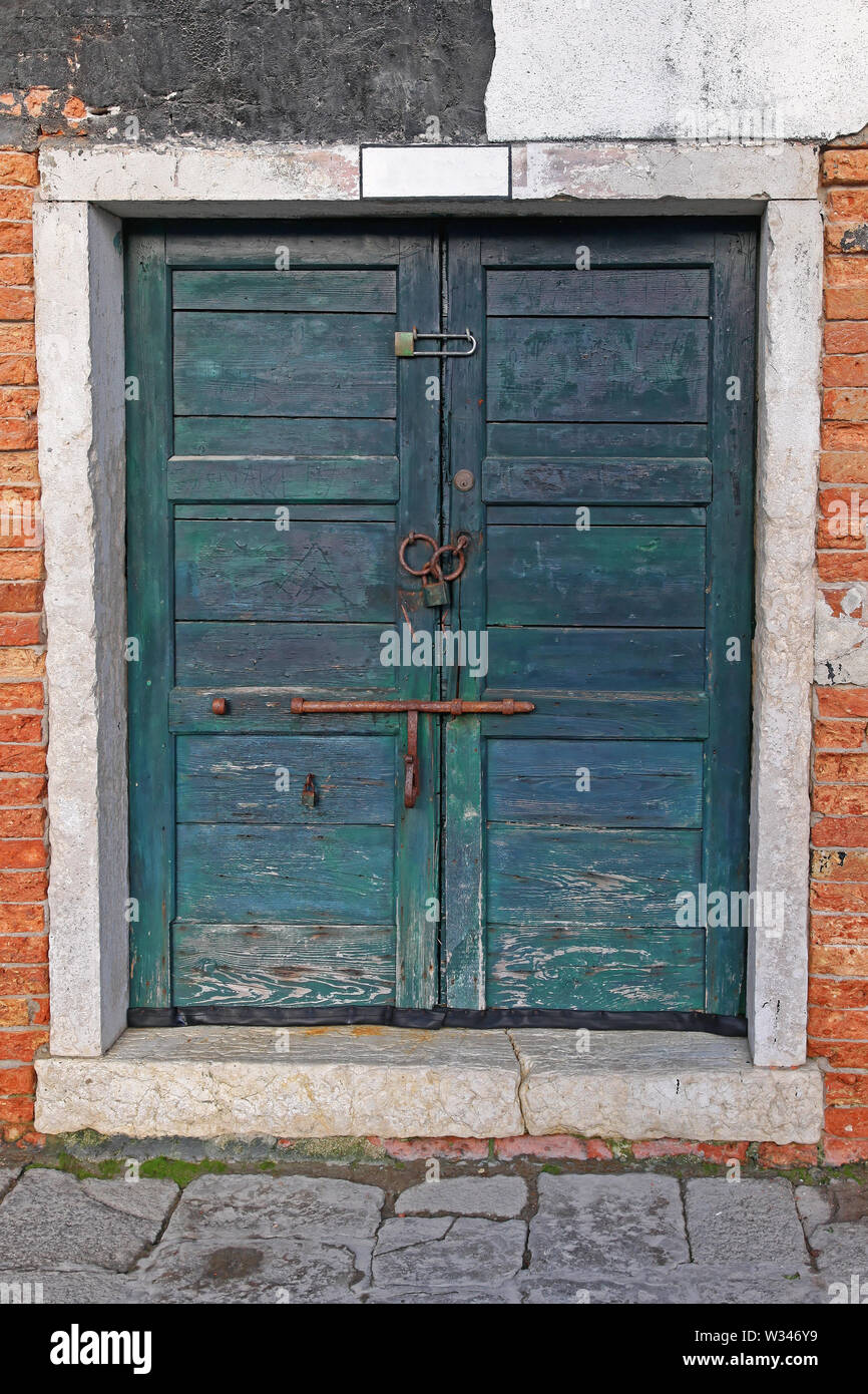 Closed and Locked Double Wooden Door in Venice - Stock Image