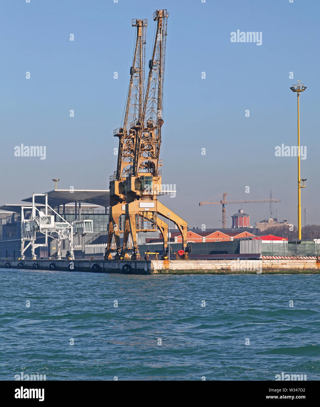 Two Big Cranes at Commercial Dock in Port of Venice - Stock Image