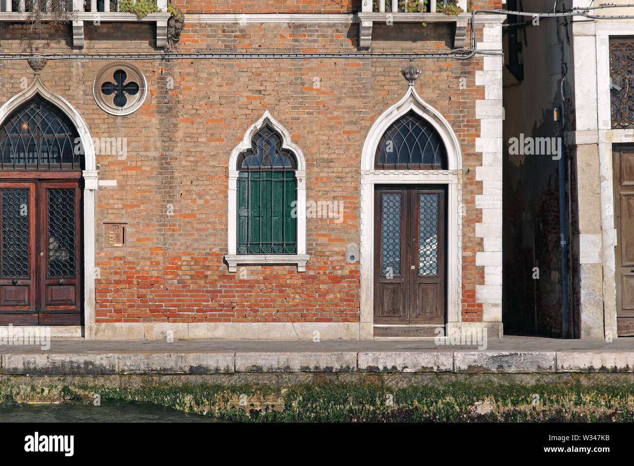Arch Door and Window at House in Venice Italy - Stock Image