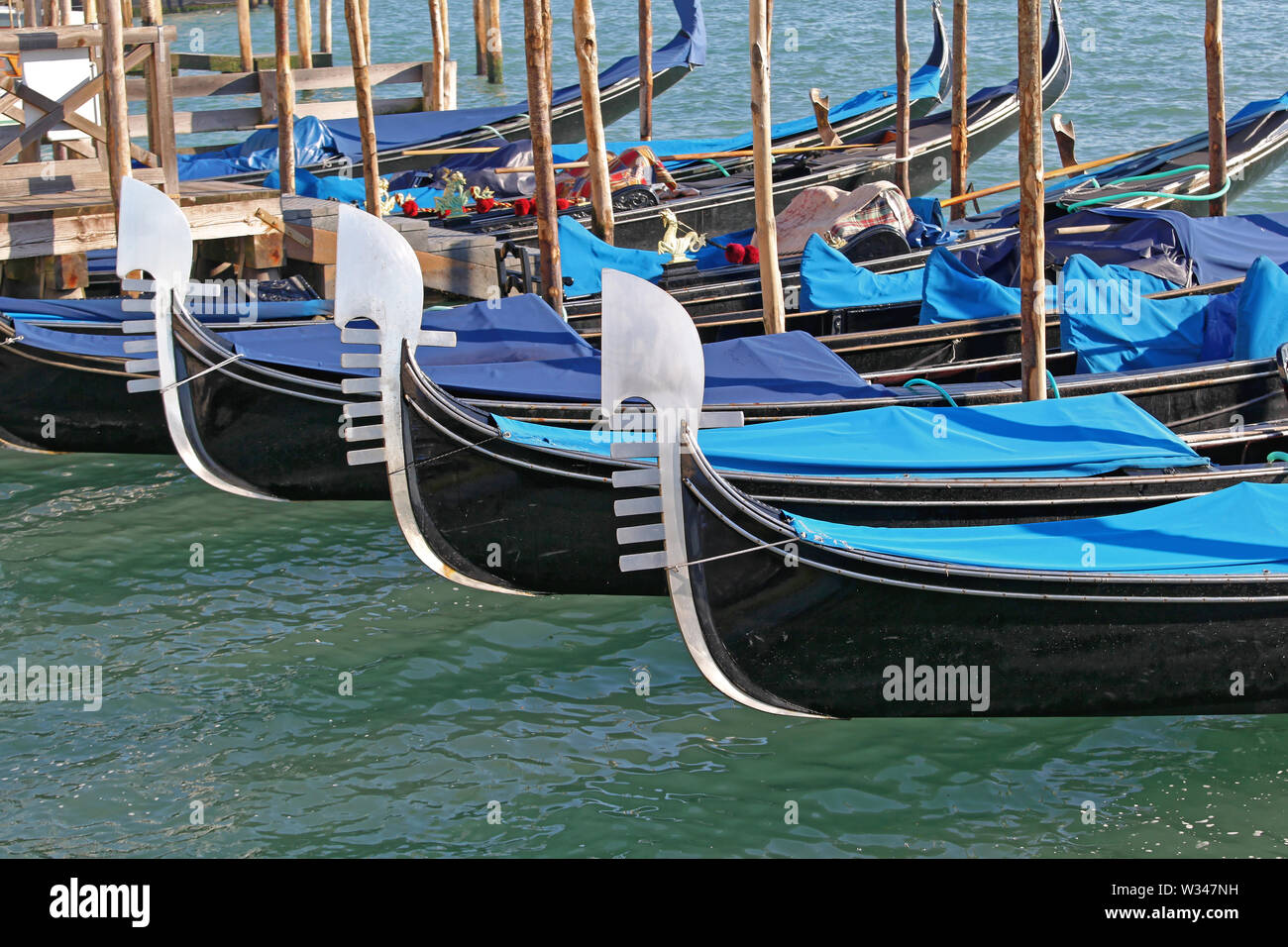 Moored Gondolas at Canal in Venice Italy - Stock Image
