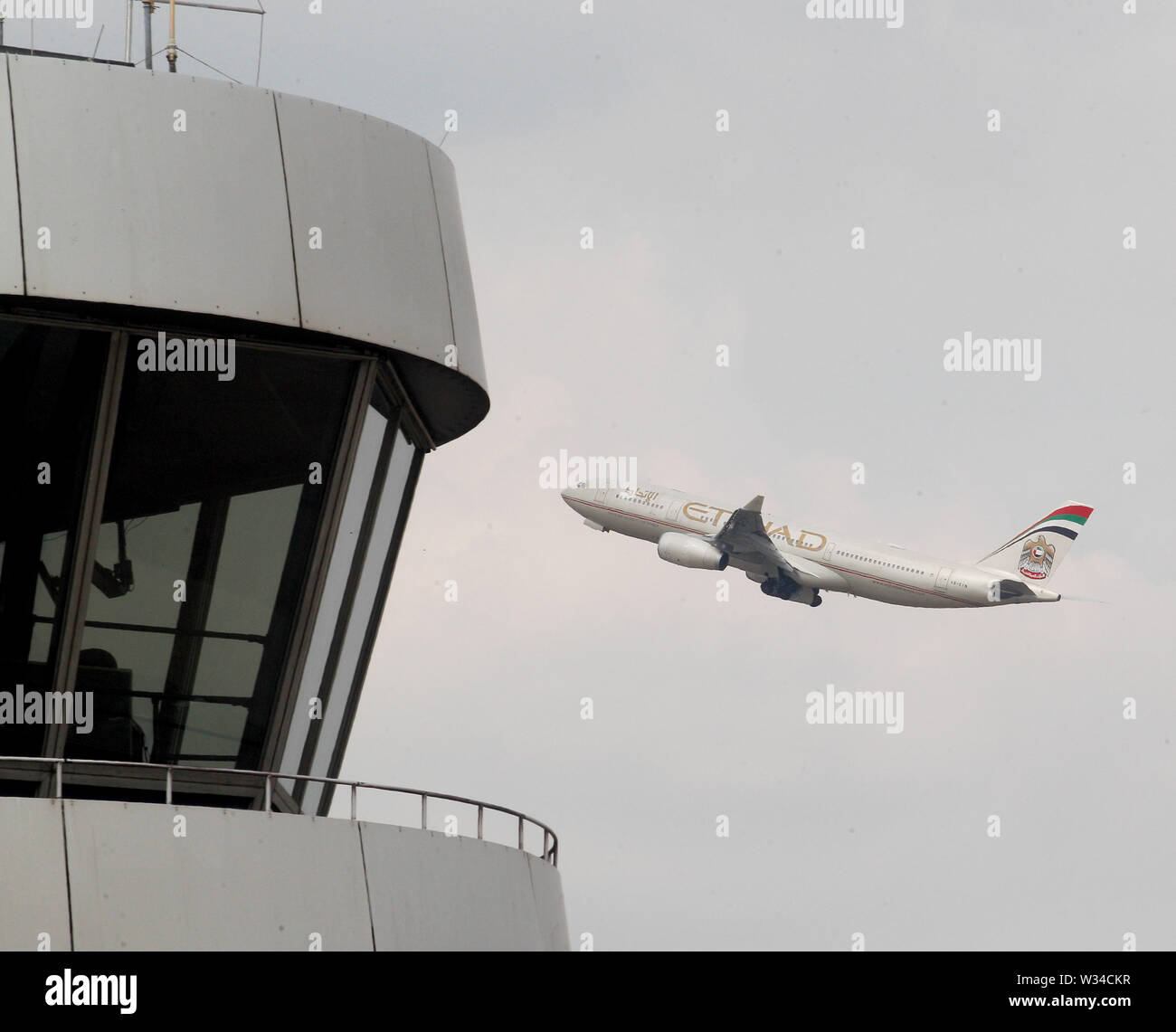 Duesseldorf, Germany. 12th July, 2019. An aircraft of the airline 'Etihad' takes off from Düsseldorf airport. Summer holidays begin in North Rhine-Westphalia. Directly on the last school day the travel wave starts, many families start into the vacation. Credit: Roland Weihrauch/dpa/Alamy Live News - Stock Image