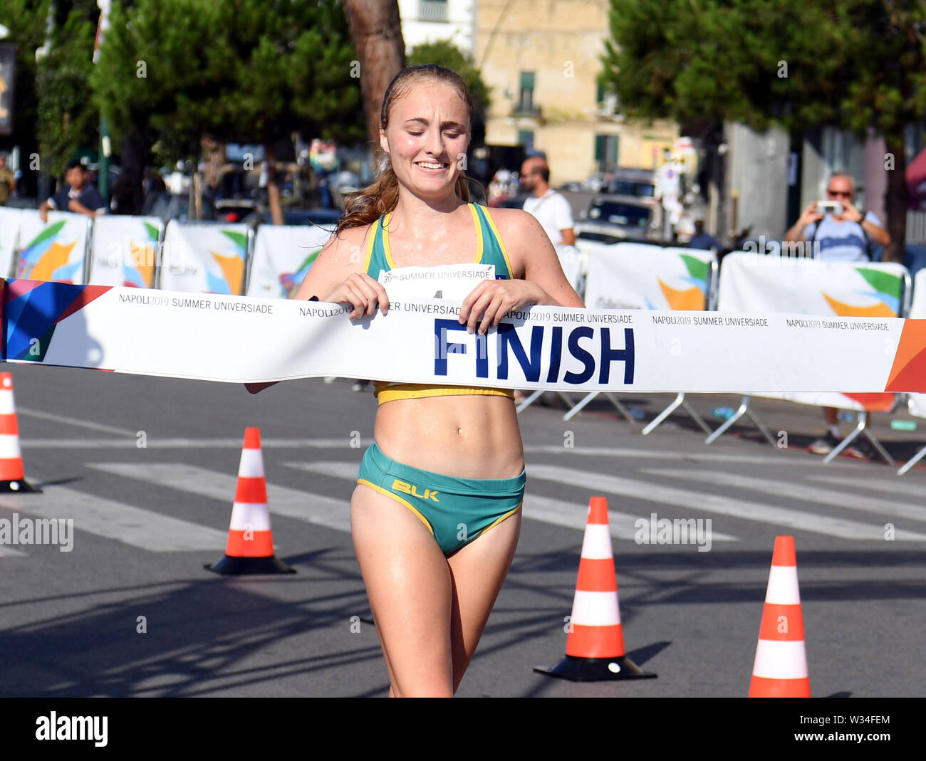 Naples, Italy. 12th July, 2019. Katie Hayward of Australia competes during the final match of Women's 20km Walk at the 30th Summer Universiade in Naples, Italy, July 12, 2019. Credit: Kong Hui/Xinhua/Alamy Live News Stock Photo