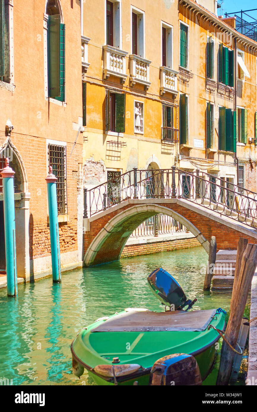 Small bridge over side canal in Venice, Italy - Stock Image