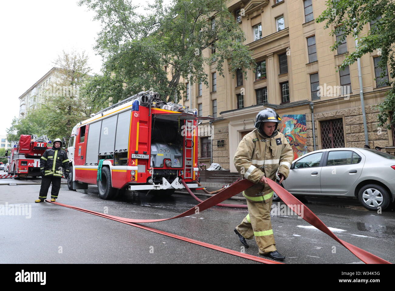 Moscow, Russia. 12th July, 2019. MOSCOW, RUSSIA - JULY 12, 2019: Firefighters by the building of the Russian State Archive of Literature and Art hit by fire. The 150 sq.m. fire on the 4th floor of the building has been extinguished. Gavriil Grigorov/TASS Credit: ITAR-TASS News Agency/Alamy Live News - Stock Image