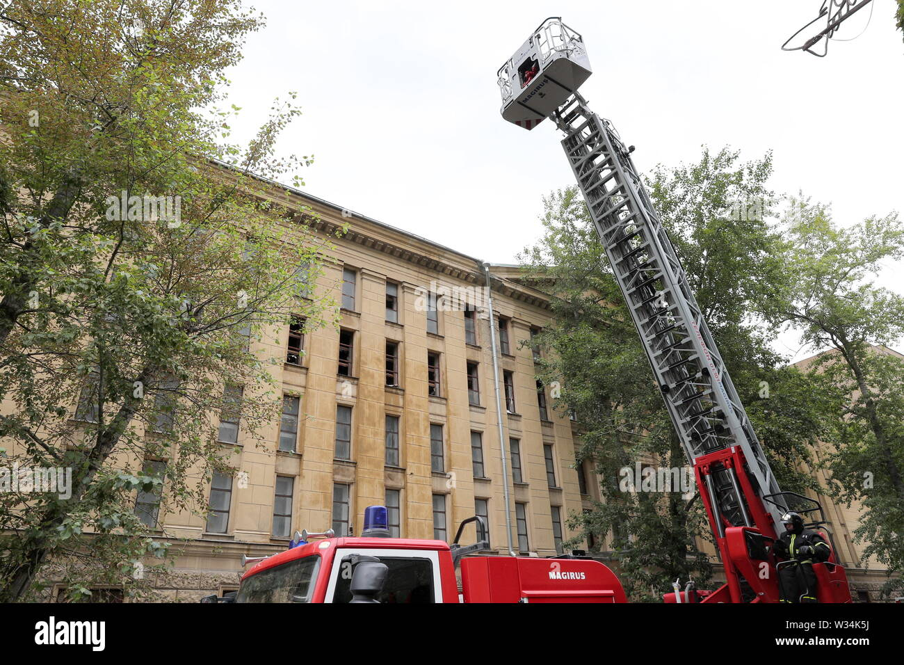 Moscow, Russia. 12th July, 2019. MOSCOW, RUSSIA - JULY 12, 2019: A view of the building of the Russian State Archive of Literature and Art hit by fire. The 150 sq.m. fire on the 4th floor of the building has been extinguished. Gavriil Grigorov/TASS Credit: ITAR-TASS News Agency/Alamy Live News - Stock Image