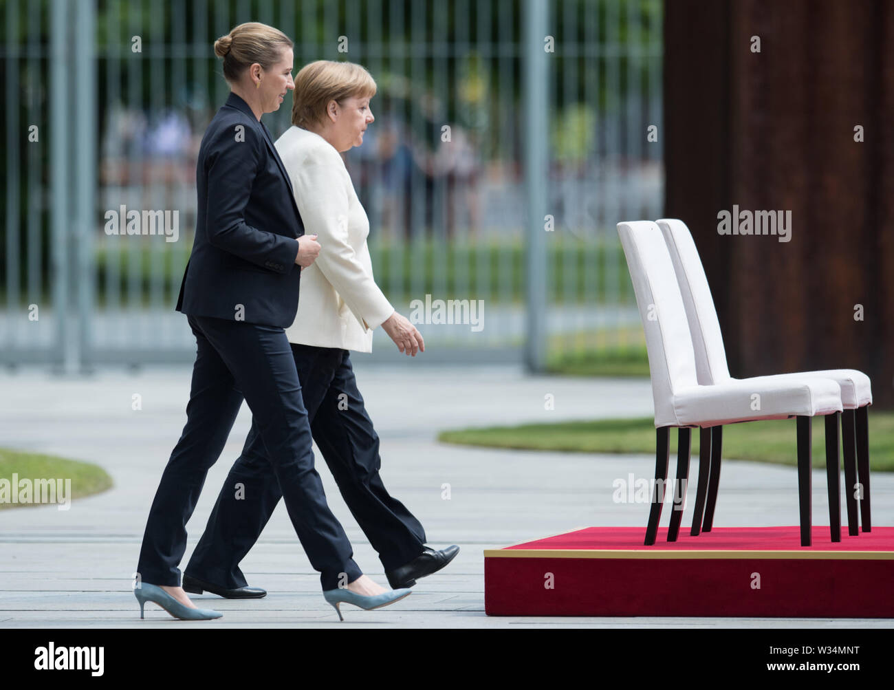 Federal Chancellor Angela MERKEL and Prime Minister Mette FREDERIKSEN Welcome and welcome by the Federal Chancellor with military honors to the Minister President of the Kingdom of Denmark in the Ehrenhof of the Federal Chancellery in Berlin, Germany on 11.07.2019. ¬   usage worldwide Stock Photo