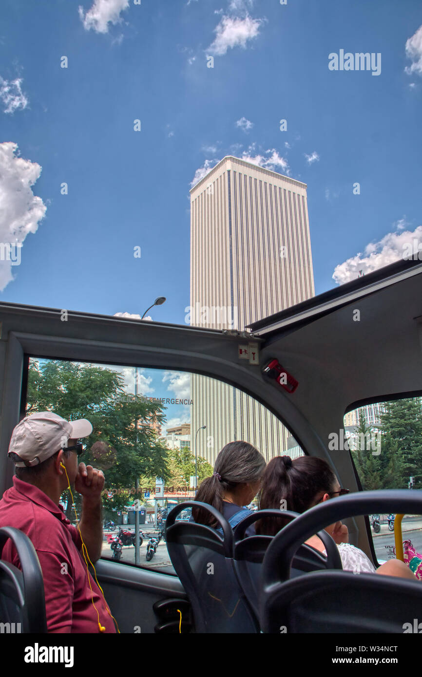 Madrid, Spain - June 21, 2019: Tourists visiting Madrid, the capital of Spain, in a singhseeing bus Stock Photo