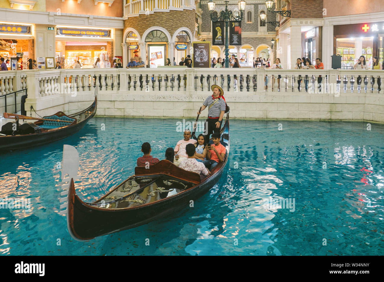 Gondola and canal in the shopping mall of the Venetian Macao. - Stock Image