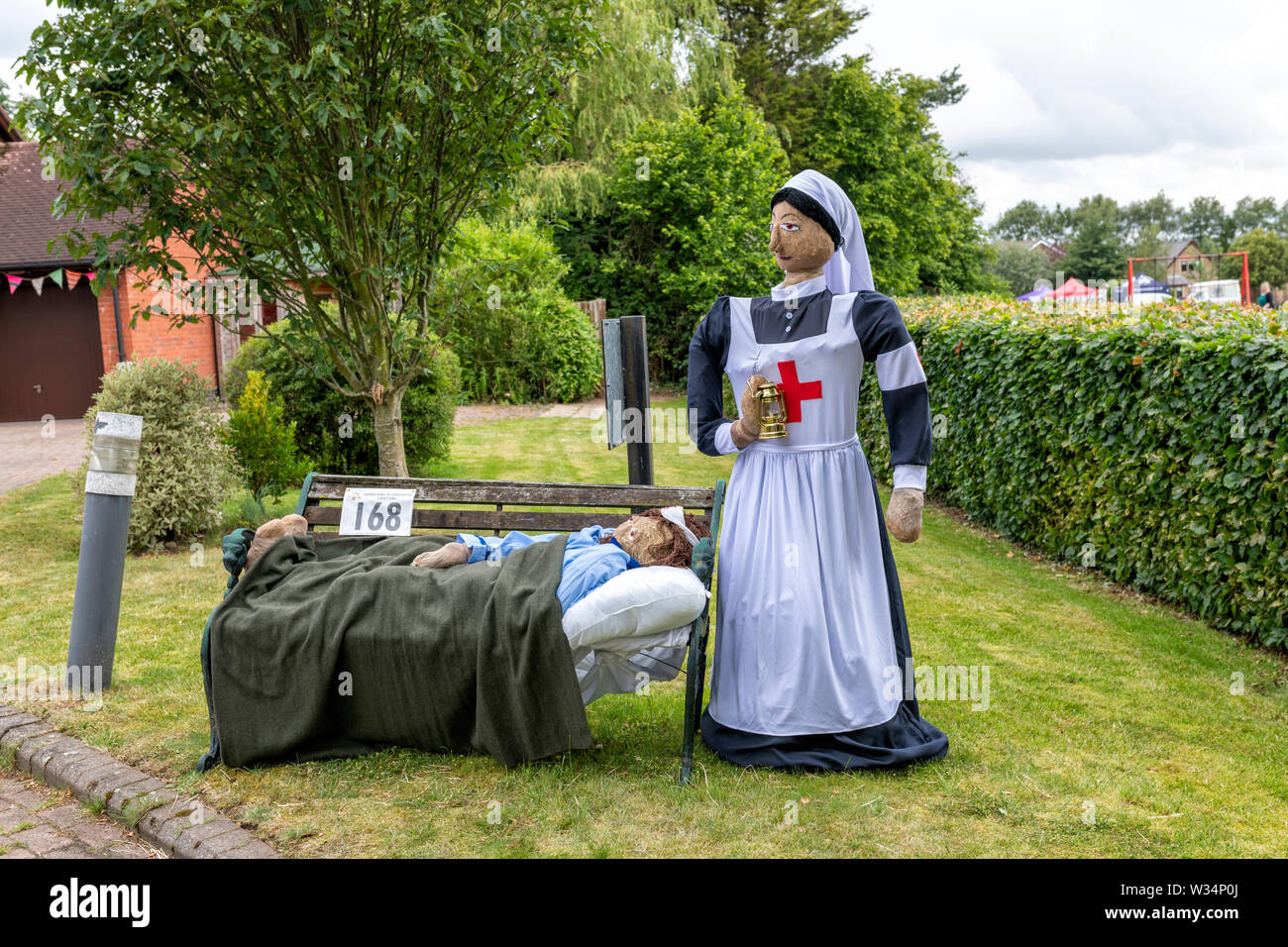 An exhibit at the Garstang Scarecrow Festival. A nurse scarecrow and her patient - Stock Image