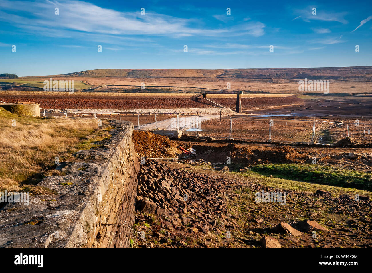 The middle reservoir of the Redmires complex near Sheffield, with the water drained for renovation works. Stock Photo