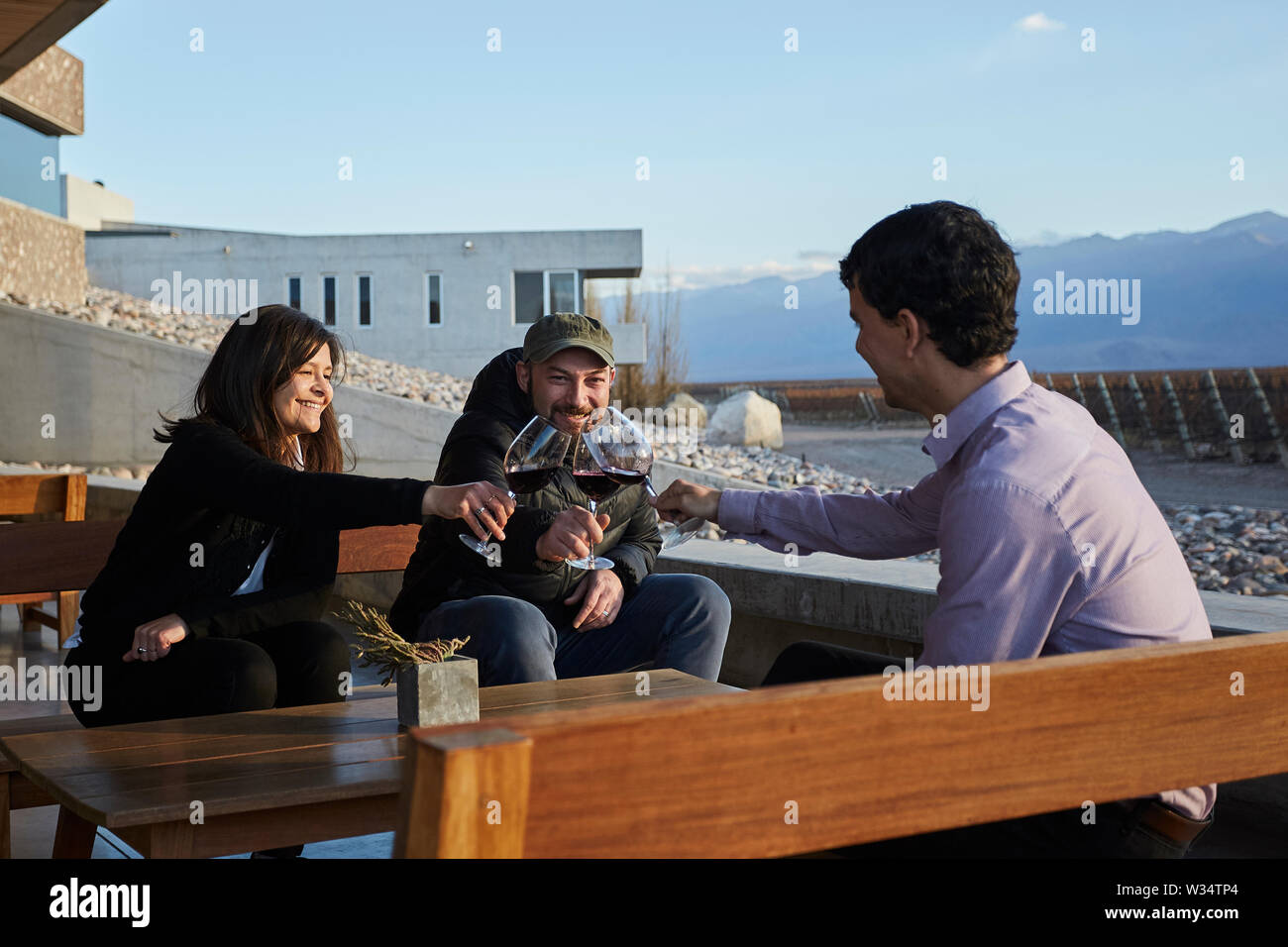11 July 2019, Argentina, San Carlos: Visitors to Piedra Infinita drink to the vineyards. The Argentinian winery Piedra Infinita of the brand Zuccardi, was awarded by the World's Best Vineyards Academy as the best winery and winery in the world. This award recognizes the best 50 wineries in the world, based on the experience offered to the visitor. Photo: Marcelo Aguilar/dpa - Stock Image