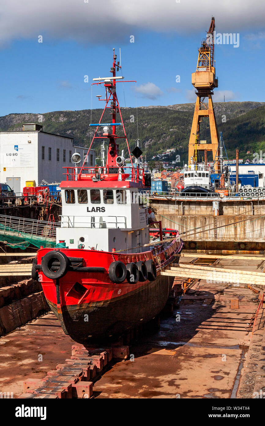 Veteran tug boat Lars at old BMV ship yard drydock in port of Bergen, Norway. - Stock Image