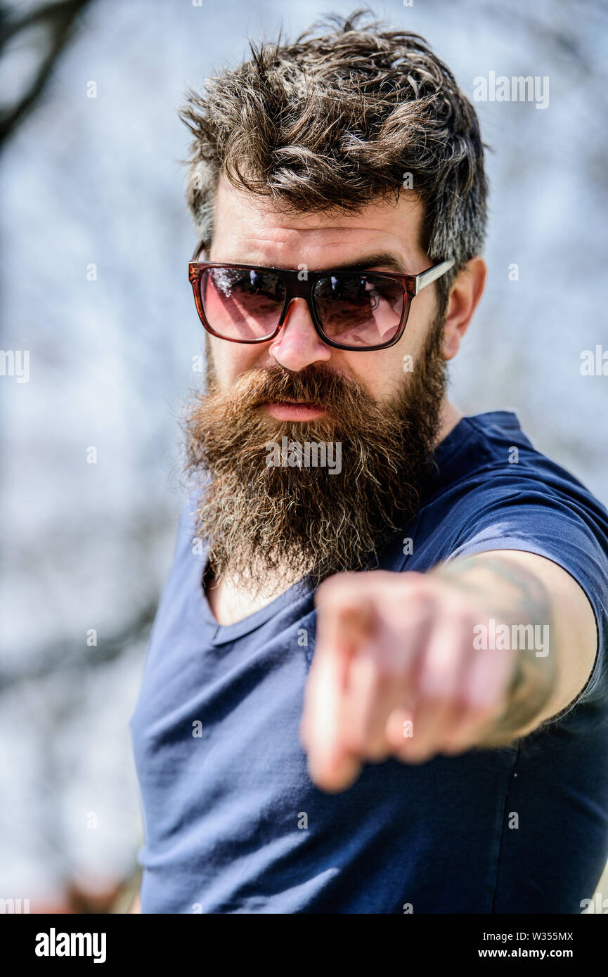 UV filter. Bearded hipster brutal man wear protective sunglasses. Man bearded with sunglasses nature background. Bearded man wear modern fashionable sunglasses. Hipster confident in dark sunglasses. - Stock Image