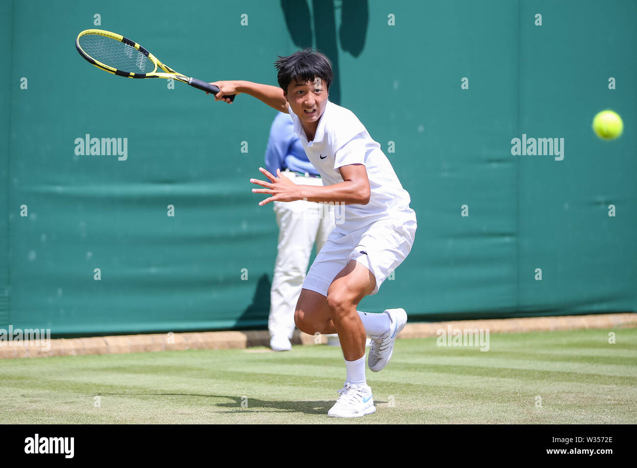 Wimbledon, London, UK. 12th July 2019. Wimbledon, London, UK. 12th July 2019.Shintaro Mochizuki of Japan during the boy's singles semi-final match of the Wimbledon Lawn Tennis Championships against Martin Damm of the United States at the All England Lawn Tennis and Croquet Club in London, England on July 12, 2019. Credit: AFLO/Alamy Live News Stock Photo