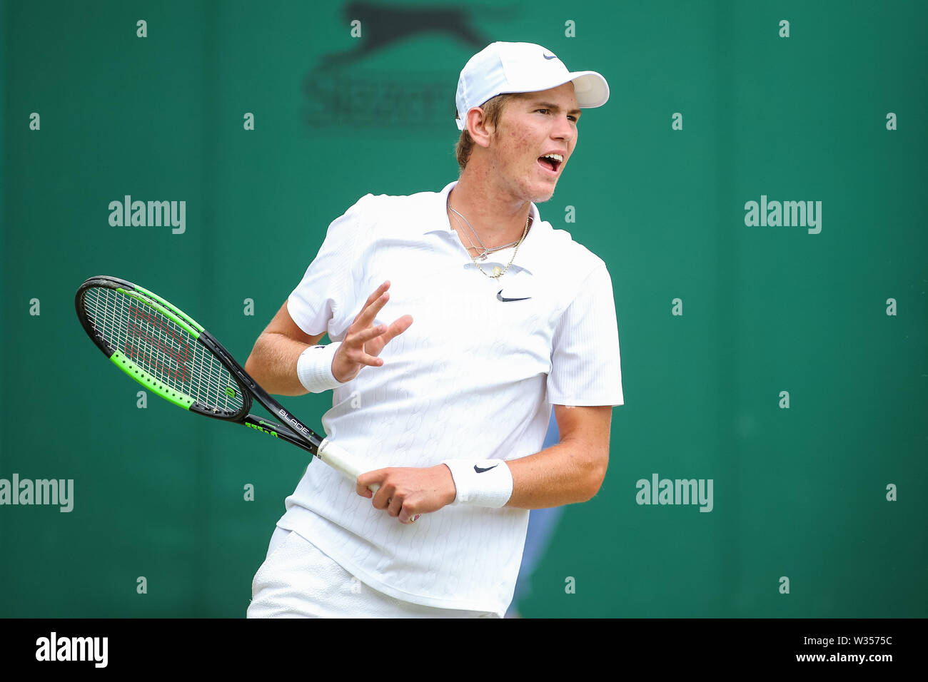 Wimbledon, London, UK. 12th July 2019. Wimbledon, London, UK. 12th July 2019.Martin Damm of the United States during the boy's singles semi-final match of the Wimbledon Lawn Tennis Championships against Shintaro Mochizuki of Japan at the All England Lawn Tennis and Croquet Club in London, England on July 12, 2019. Credit: AFLO/Alamy Live News Stock Photo
