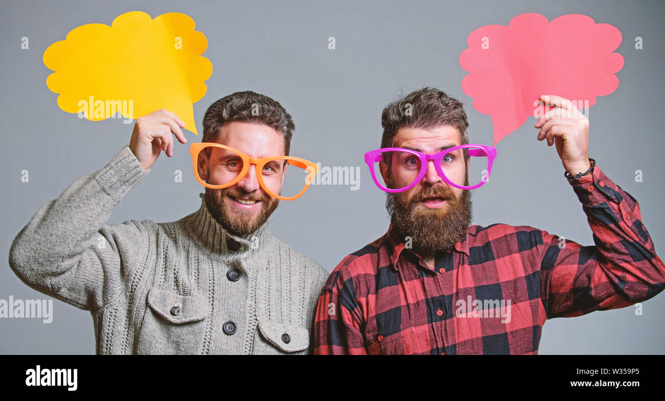 Men joking. Share opinion speech bubble copy space. Comic and humor sense. Men with beard and mustache mature hipster wear funny eyeglasses. Explain humor concept. Funny story and humor. Comic idea. - Stock Image