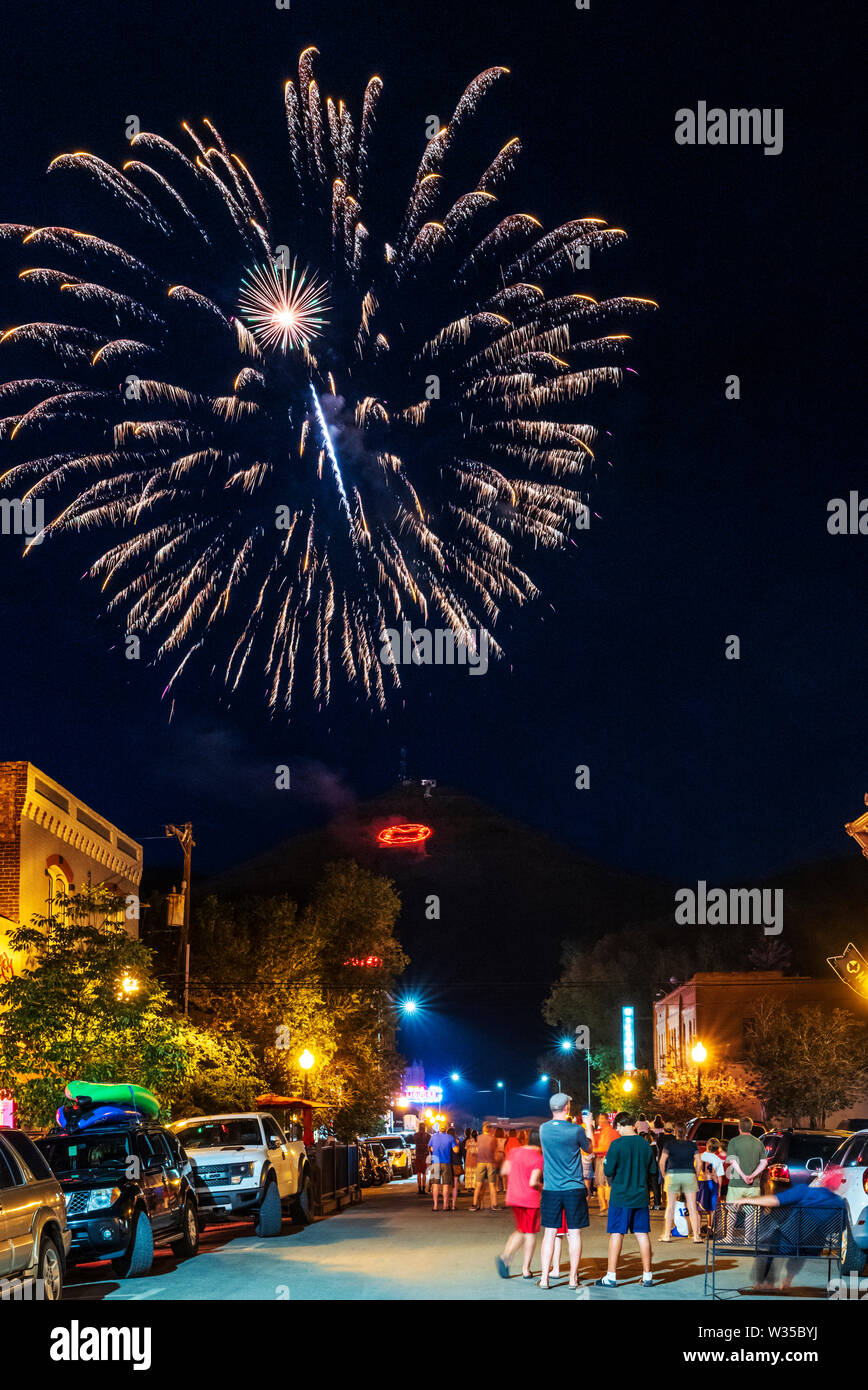 "People watch Fourth of July fireworks on ""S"" Mountain viewed from the main street in Salida, Colorado, USA Stock Photo"