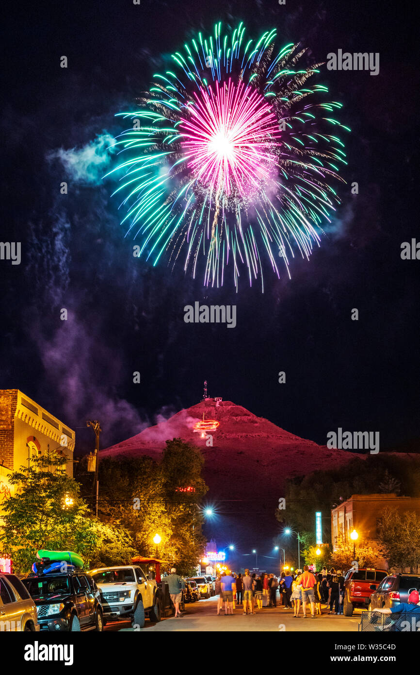 """People watch Fourth of July fireworks on """"S"""" Mountain viewed from the main street in Salida, Colorado, USA Stock Photo"""
