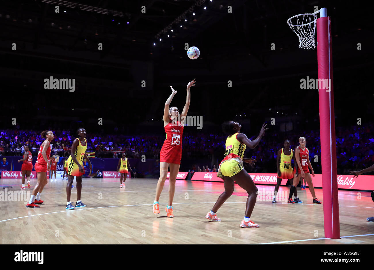 England's Joanne Harten shoots during the Netball World Cup match at the M&S Bank Arena, Liverpool. - Stock Image