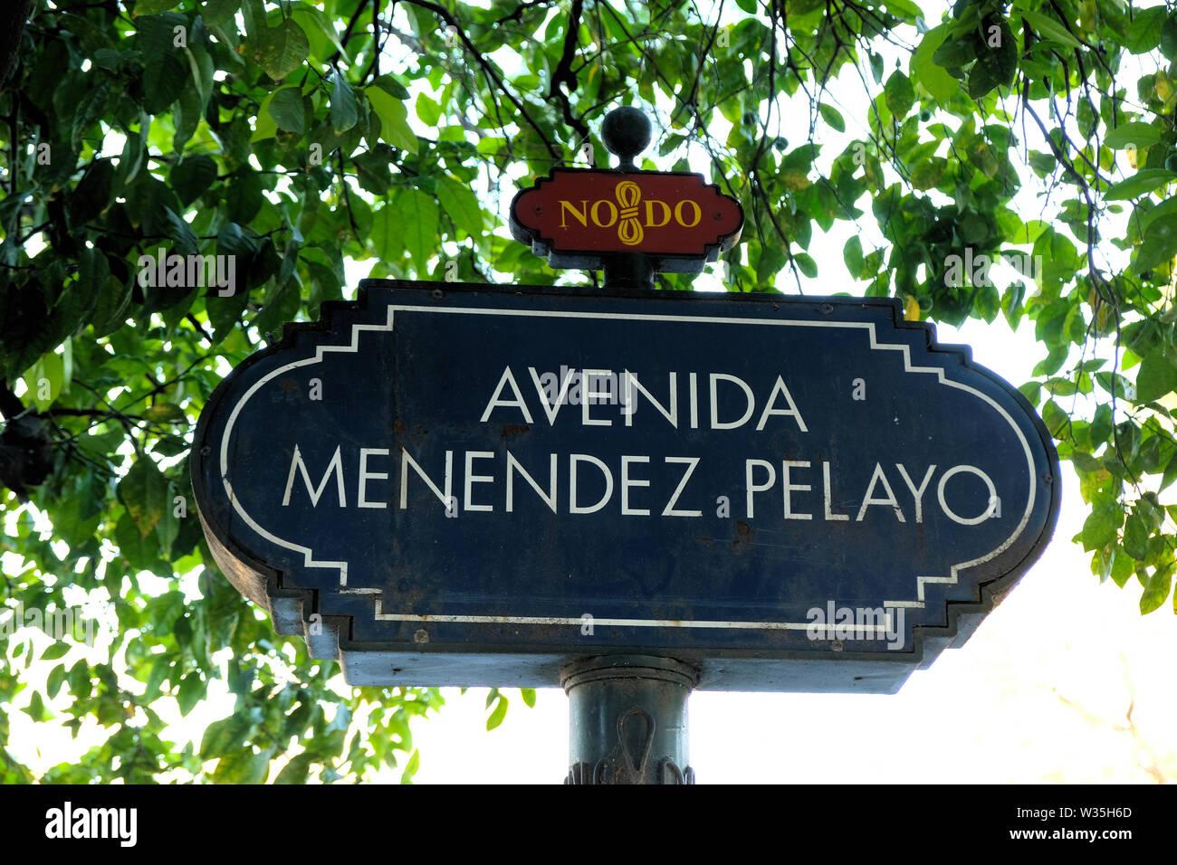 Street sign for Menendez Pelayo avenue with the NO8DO symbol in Seville, Spain; Menendez Pelayo was a Spanish scholar, historian, literary critic. - Stock Image