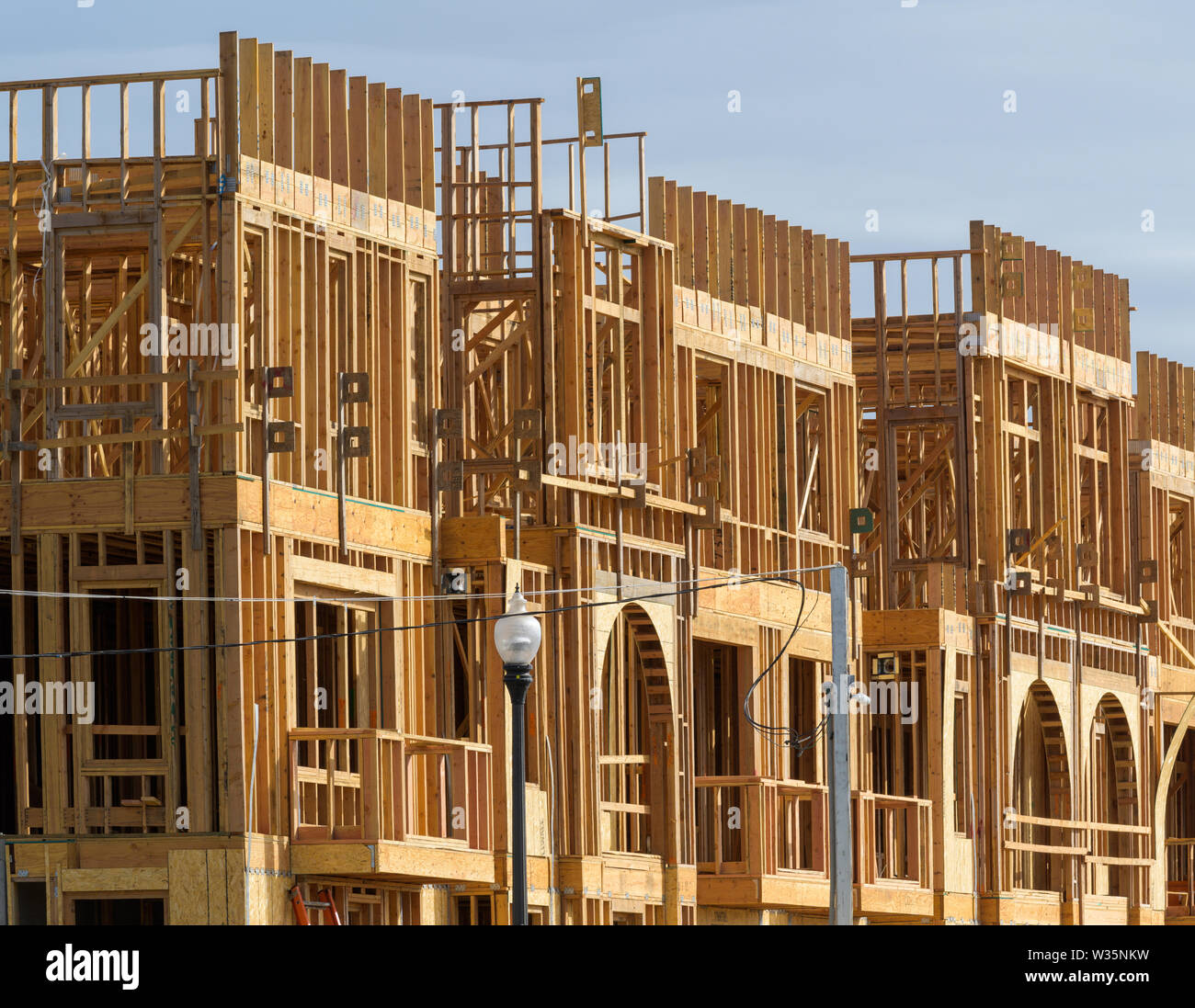 An apartment building under construction on sunny day on blue sky background Stock Photo