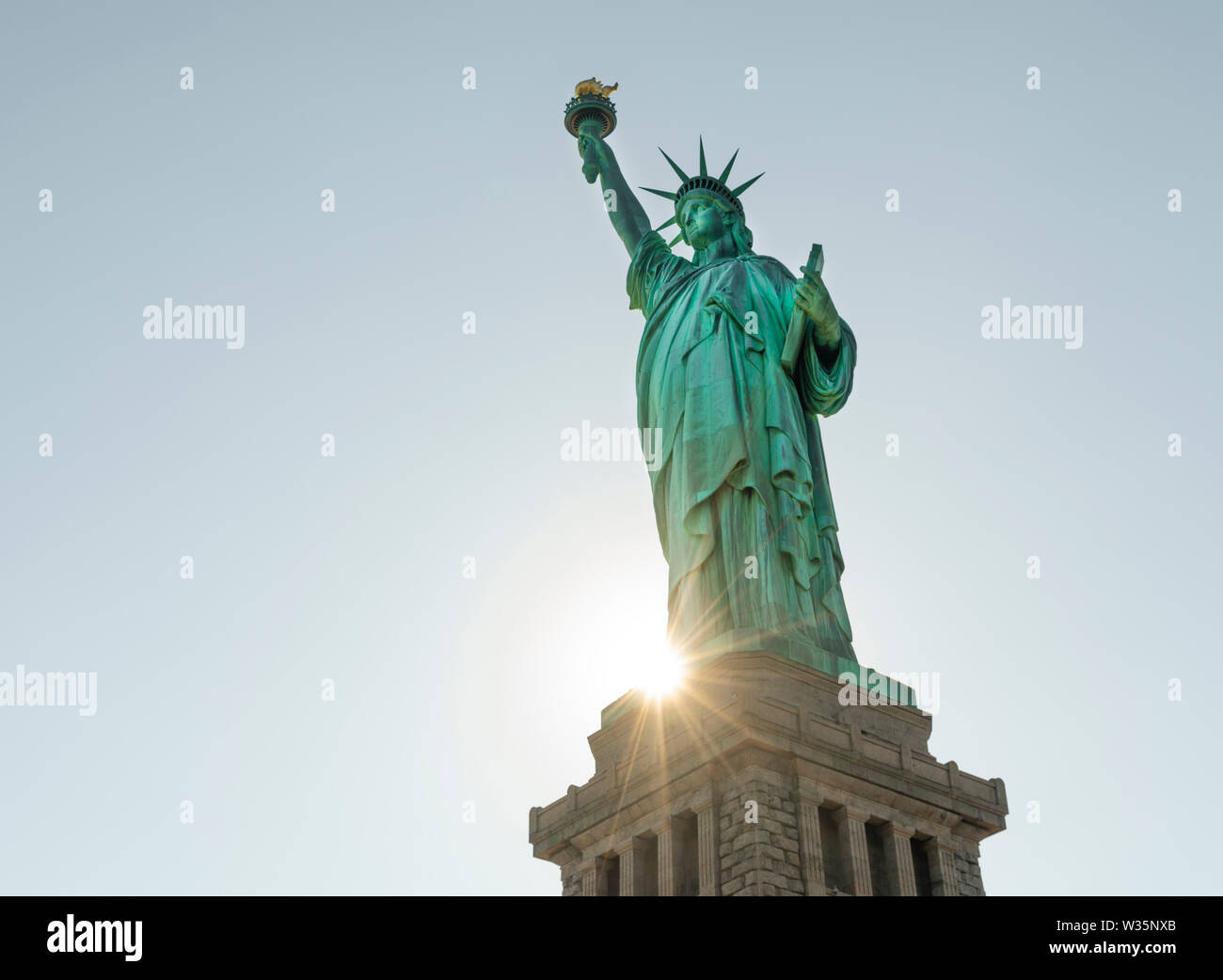 It's a cutout on white of lady liberty in the Statue of Liberty - Stock Image
